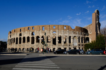 Colosseum Rome. Ruins of the  ancient Roman amphitheatre. Travel to Italy, Europe. Crowd and queue. Sunny day and blue sky
