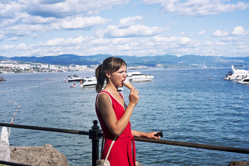 Young woman on sea cost. Sunny summer day.