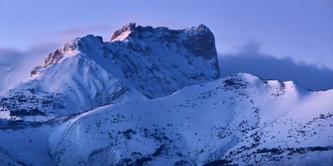 Bure Peak (Pic de Bure) in the Devoluy Mountain range at dusk in Winter. Hautes-Alpes, French Alps, France