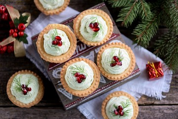 Tartlets with avocado pasta, cottage cheese, fish caviar and pomegranate.