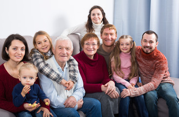 Positive family making numerous photos