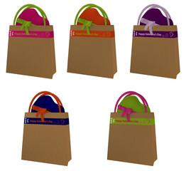 Sammlung von Einkaufstaschen mit Aufschrift für Valentine Sale in denen ein Herz steckt.