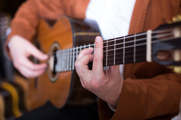 Professional guitarist practicing on guitar