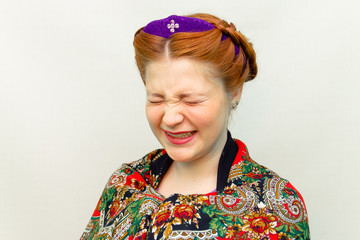 girl with a hair style in a Slavic style laughs