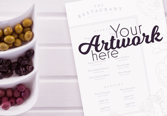 Menu Mockup with Olive Platter on White Table