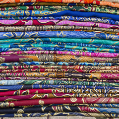 Assortment of colorful sarongs for sale, Island Bali, Ubud, Indonesia. Close up