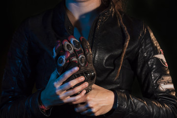 motorcycle glove  kept by a girl