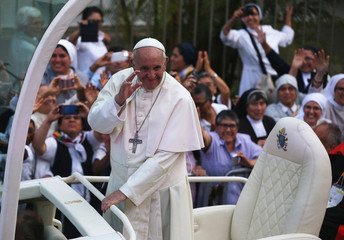 Pope Francis waves while arriving at the nunciature, in Lima