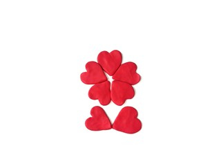 Beautiful hearts flower made from plasticine clay on white background, cute red dough