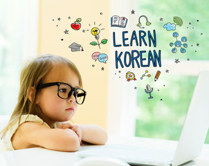 Learn Korean text with little girl using her laptop