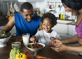 Black family eating healthy food together Wall mural