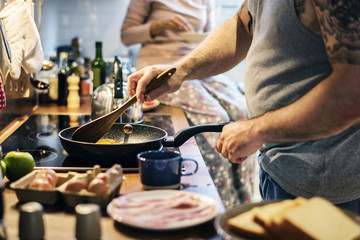 Man cooking breakfast in the kitchen
