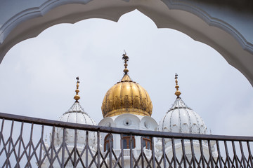 White and golden domes of mosques
