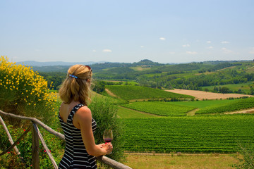 Europe Woman with Wine Looking at Tuscany Valley