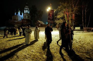 People participate in a sacred procession to celebrate Orthodox Epiphany in the village of Drachevo, outside Moscow, Russia