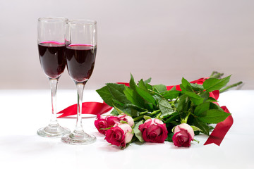 Two glass of wine and roses bouquet for lover in Valentine day