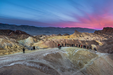 Photographers and Tourists shooting Zabriskie's Point Sunrise in Death Valley, California, United States