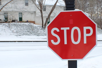 Stop sign on icy road