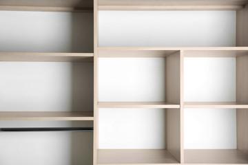 Empty wardrobe shelves, closeup