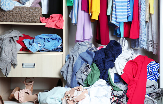 Wardrobe with messy clothes, closeup