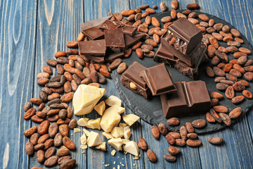 Composition with chocolate and cocoa products on wooden background