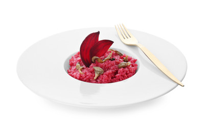 Plate with tasty beetroot risotto with mushrooms on white background