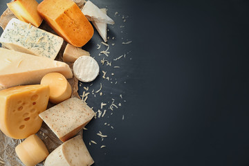 Variety of cheese on dark background
