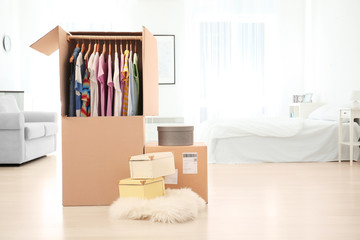 Wardrobe boxes with clothes indoors