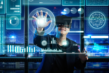 Businessman wearing virtual reality glasses search financial solution with futuristic computer screen , future e-business concept .