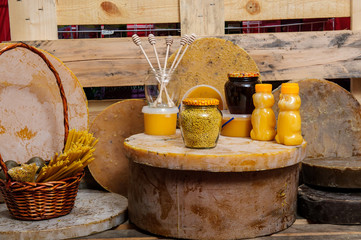 Various bee products - honey, honey with wax and propolis. Products of livelihoods of bees. Wax. Cells. Honey.Beekeeping.