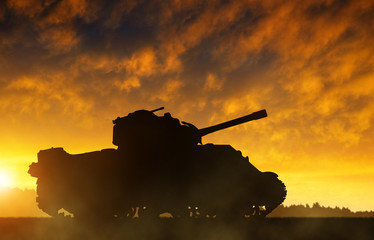The silhouette of the tank at sunset.