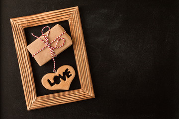 Heart and gift in wooden  picture frame
