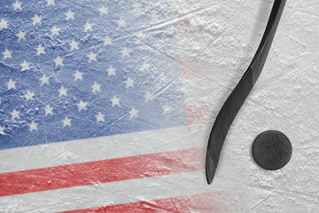 Image of American flag and hockey stick with puck