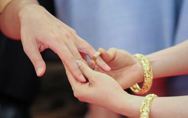 Wearing dress Thai wedding a Rings.