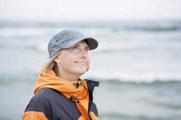 Side view of woman walking on beach