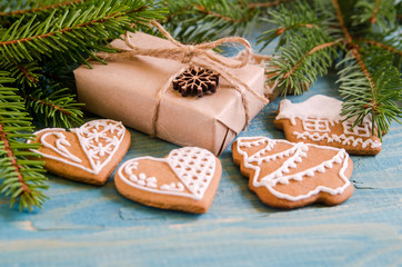 Christmas still life with gifts on a blue wooden background with a Christmas tree. New Year gifts