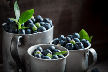 Sweet blueberry on old wooden rustic floor