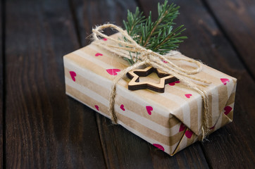 Christmas still life with gifts on a black wooden background with a Christmas tree. New Year gifts