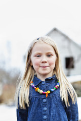 Portrait of little blonde girl with colorful coral necklaceåÊ