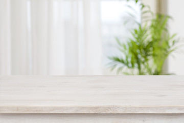 Table mockup for display of product over blurred window background