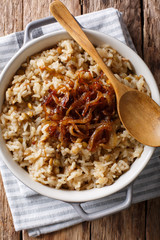 Vegetarian Mujaddara from rice and lentils with caramelized onion macro. Vertical top view