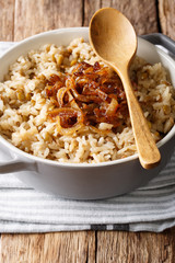 Arabic cuisine: rice with lentils and fried onions close-up in a bowl. vertical