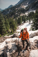 Female hiker trekking on lycian way up snowy Tahtali