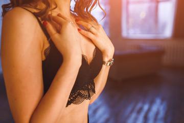 Woman in black bra, sensual portrait in studio