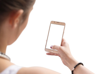 Isolated scene. Woman use mobile phone. View behind shoulder.