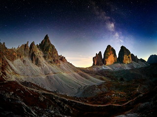 Alps Mountain landscape with night sky and Mliky way Tre Cime di Lavaredo, Dolomites