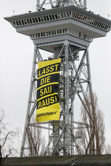 """A Greenpeace banner reading """"let the sow out"""" is seen on the radio tower during the opening of the Green Week international food, agriculture and horticulture fair in Berlin"""