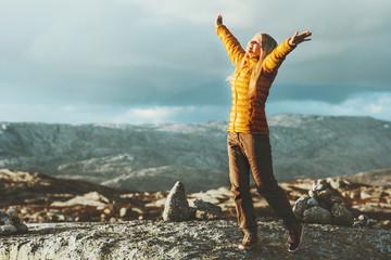Happy Woman raised hands enjoying landscape in mountains outdoor wanderlust Travel healthy Lifestyle success concept adventure scandinavian vacations