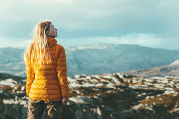 Traveler Woman outdoor mountaineering Travel healthy Lifestyle concept blonde girl adventurer enjoying scandinavian mountains landscape
