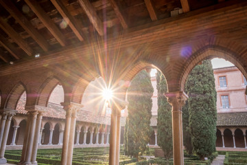TOULOUSE FRANCE - November 16th 2017; Cloisters of the Gothic 'Church of the Jacobins' facing sun of Toulouse